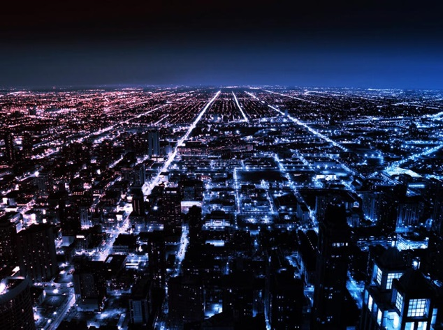 Image of a city at night with lights stretching to the horizon.