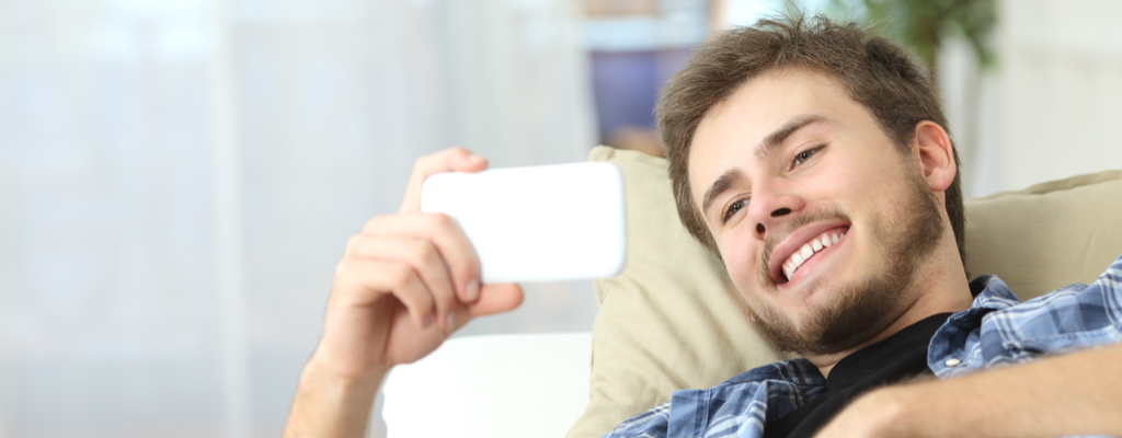 Man Watching Movie on Phone