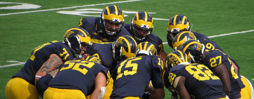 Michigan Football Huddle