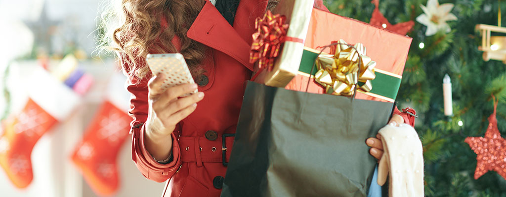woman with presents and phone