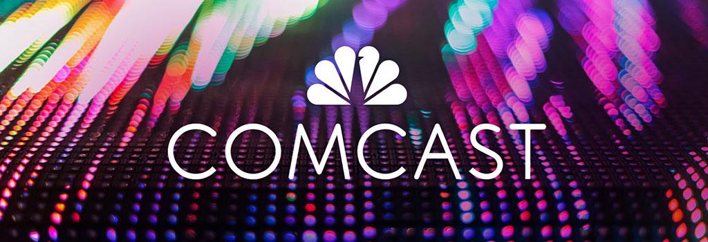 logotipo oficial de comcast en blanco