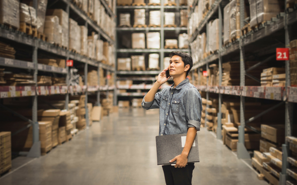 manager on phone in warehouse