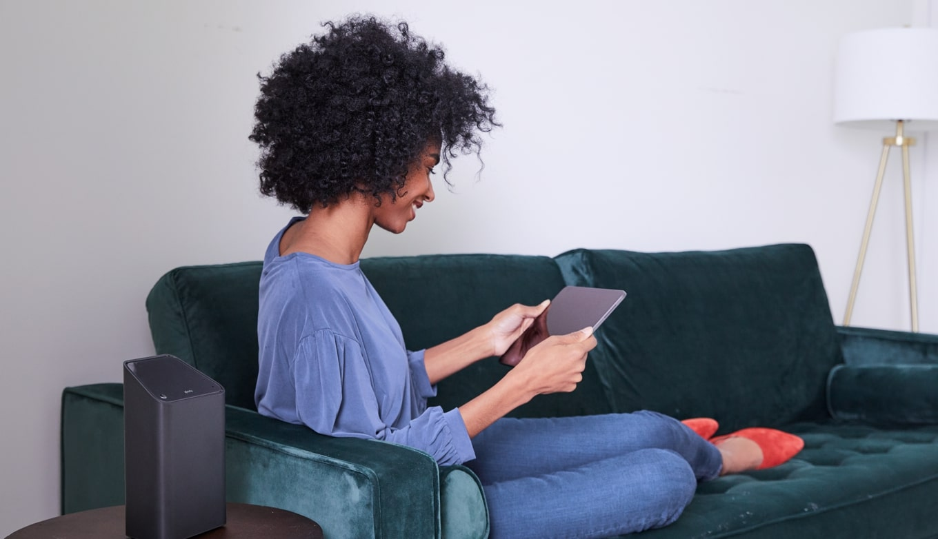 Woman lounging on couch watching tablet