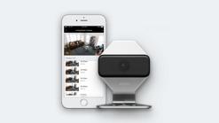 cámara de xfinity home security y teléfono celular