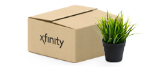 Moving box with Xfinity logo next to plant
