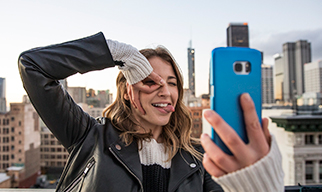 Slim image - girl making face holding blue phone