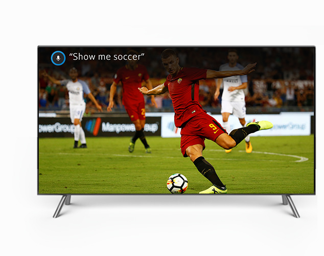 Soccer player in action on TV screen
