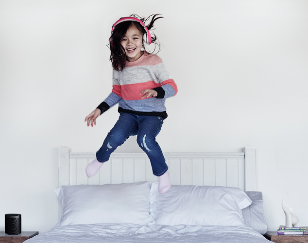 Child jumping on bed