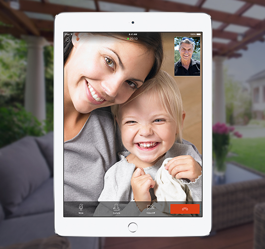 Woman and child video calling on tablet with man