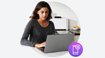 Woman typing on laptop with purple mobile icon on bottom right