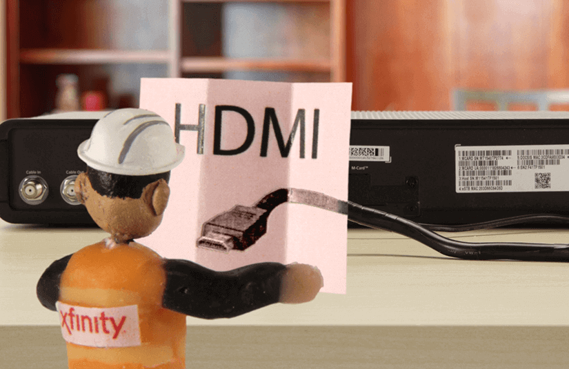 Xfinity Tiny Technician looking at HDMI instructions